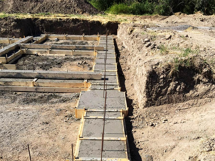 Mettler Construction - close up of footings poured for Burgess Ave custom home project in Merritt