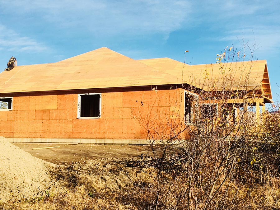 Sheeting the roof at the Burgess Avenue project by Mettler Construction in Merritt BC