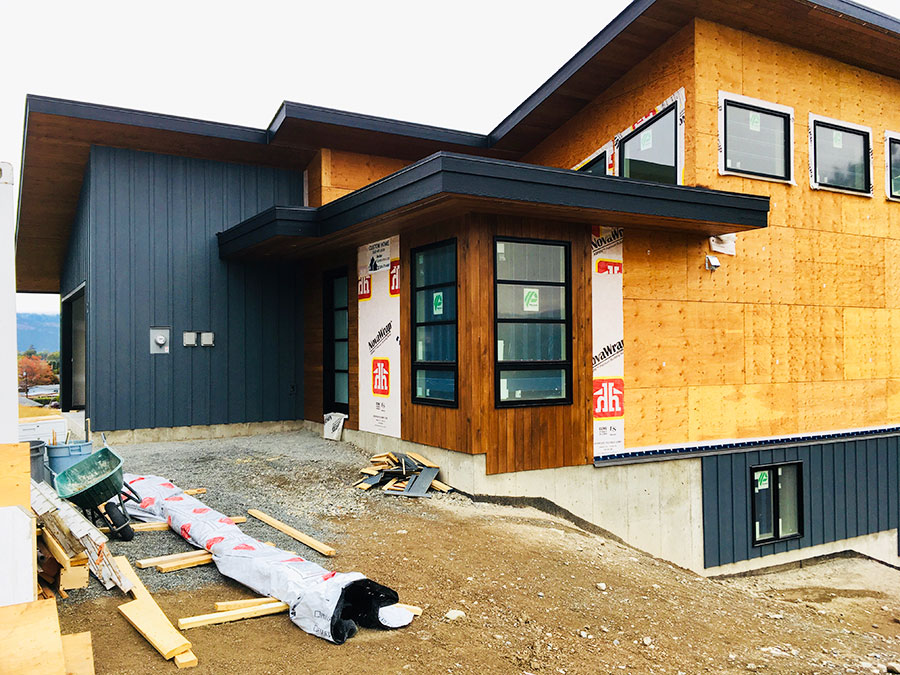 Siding going on at the Fir Road project by Mettler Construction in Merritt, BC