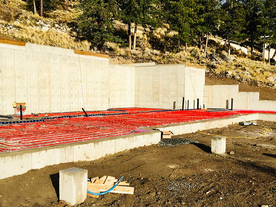 Prepping garage and basement floors for concrete at Nicola Lakeshore Estates project by Mettler Construction in Merritt, BC