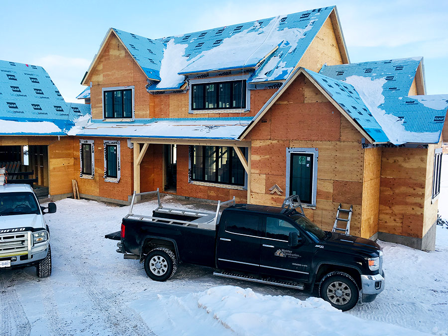 Working in the snow at Nicola Lakeshore Estate project by Mettler Construction Ltd in Merritt, BC