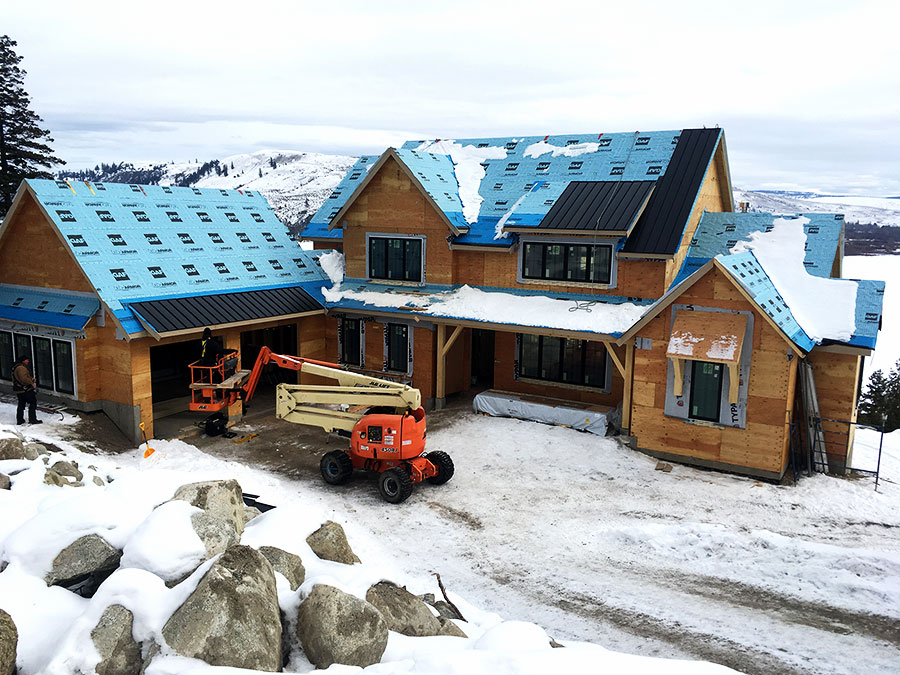 Working on the roof in the snow at Nicola Lakeshore Estate project by Mettler Construction Ltd in Merritt, BC